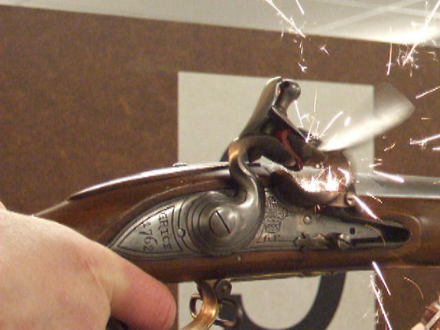Close up of  75 calibre Brown Bess musket lock (firing sequence)